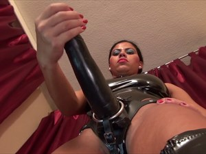 India in black PVC with Strap-on